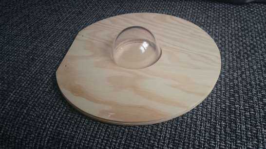 wooden cover with plastic hemisphere