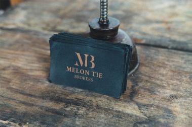 Melon Tie Broker black business card